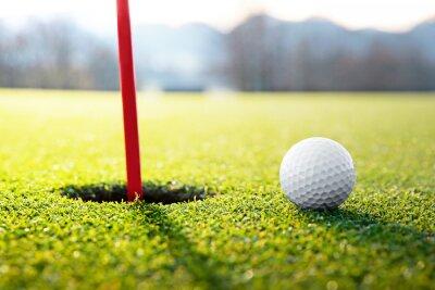 Fototapeta golf ball near the hole