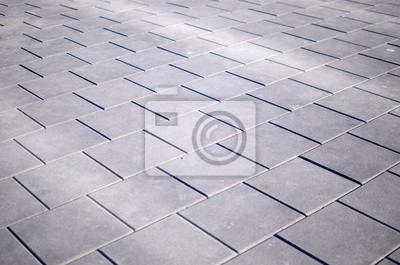Fototapeta Gray paving slabs in the city