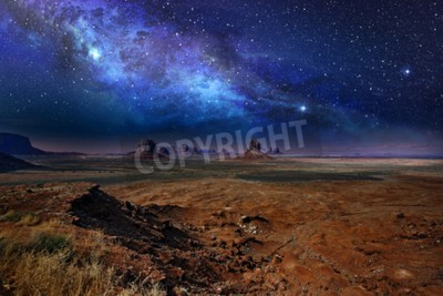 Fototapeta Gwiaździste nocne niebo nad doliną pomników