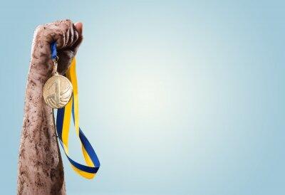 Fototapeta Hands tighten medal