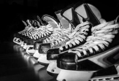 Fototapeta Hockey skates lined up in locker room