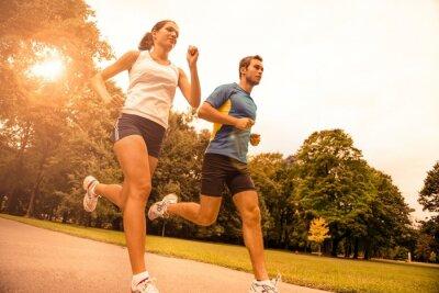 Fototapeta Jogging together - sport young couple