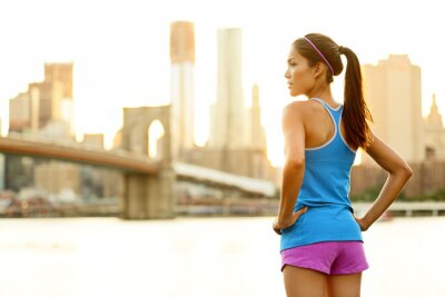 Fototapeta Kobieta fitness Biegacz relaksu po uruchomieniu miasta