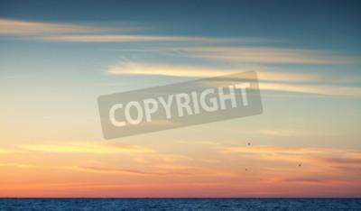 Fototapeta Kolorowe niebo słońca nad Oceanem Atlantyckim, naturalne zdjęcie tła z ciepłym tonalnej filtr korekcji zdjęć