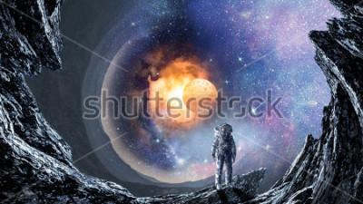 Fototapeta Kosmiczna dziura i astronauta. Różne środki przekazu