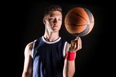 Fototapeta Koszykarz wirowania piłki na palcu