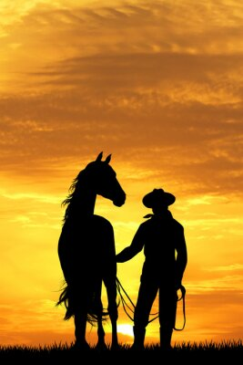 Fototapeta Kowboj z konia o zachodzie słońca