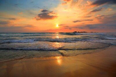 Fototapeta landscape with sea sunset on beach