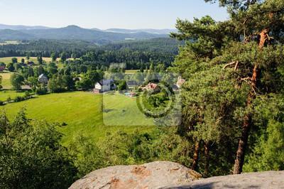 Fototapeta Letni krajobraz z lasami, łąk skał i nieba