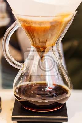 Fototapeta Making brewed coffee from steaming filter drip style