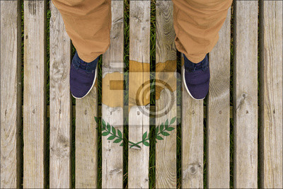 Fototapeta man stepped on a flag of Cyprus painted on a wooden floor