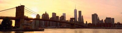 Fototapeta Manhattan skyline panoramy z Brooklyn Bridge na zachodzie słońca, New York, Stany Zjednoczone