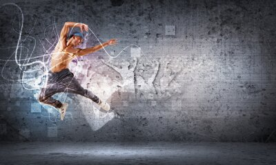 Fototapeta Młody mężczyzna tańczy hip hop z liniami koloru