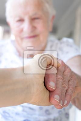 Fototapeta Młody ręka trzyma rękę pani starszych