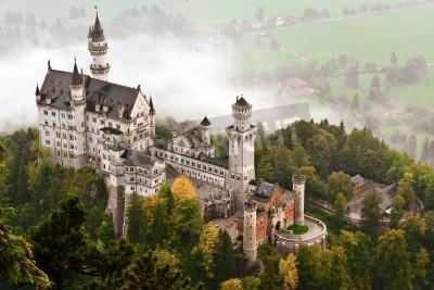 Fototapeta Neuschwanstein Castle shrouded in mist in the Bavarian Alps of Germany.