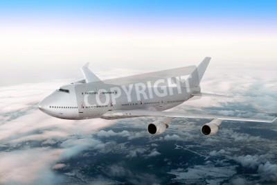 Fototapeta Nowoczesny samolot na chmury.
