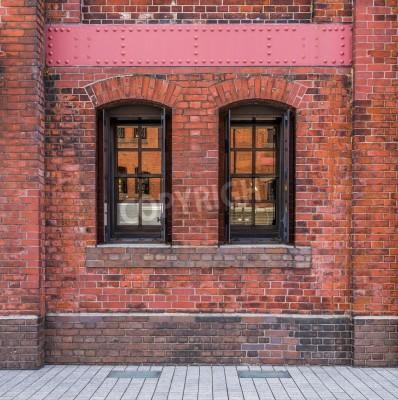 Fototapeta Okna w tle mur z czerwonej cegły