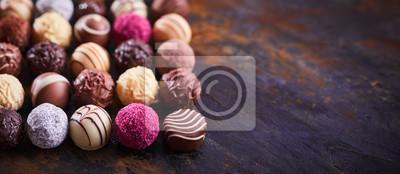 Fototapeta Panorama banner with luxury chocolate pralines