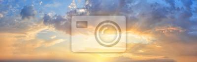 Fototapeta Panorama of orange sunset sky with bright sun