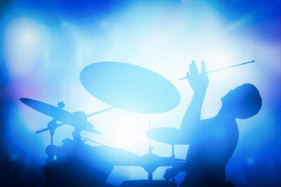 Fototapeta Perkusista gra na perkusji na koncert muzyczny. Klub światła