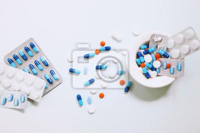 Fototapeta Pharmaceuticals antibiotics pills medicine. Colorful antibacterials pills.Capsule pill medicine