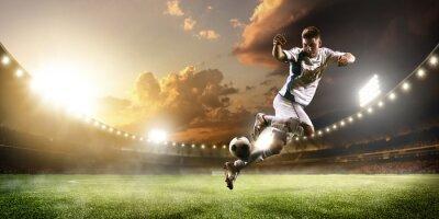 Fototapeta Piłkarz w akcji na stadionie Sunset Panorama tle
