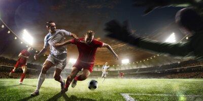 Fototapeta Piłkarzy w akcji na tle słońca panorama stadionu
