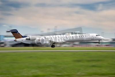 Fototapeta PRAGUE, CZECH REPUBLIC - MAY 13: Eurowings Bombardier CRJ-900 NG lands at PRG Airport on May 13, 2015. Eurowings is a German low-cost airline based in Dsseldorf.