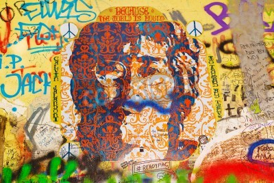 Fototapeta PRAGUE, CZECH REPUBLIC - SEPTEMBER 11, 2014: Famous John Lennon Wall on Kampa Island in Prague is filled with Beatles inspired graffiti and pieces of lyrics since the 1980s. Graffities are drawn on da