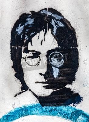 Fototapeta PRAGUE, REPUBLIKA CZESKA - 29 kwietnia 2016: Mur Lennon, portret. Ściana została wypełniona Lennonem zainspirowała graffiti i teksty z piosenek Beatlesów od lat 80. jako irytację komunizmu