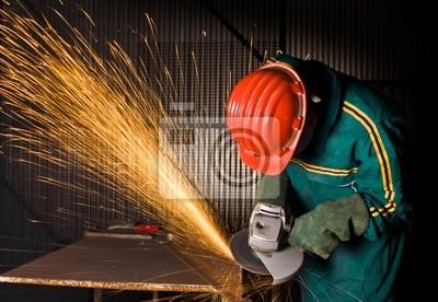 Przemysł ciężki robotnik szlifierka w tle