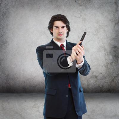 Fototapeta Przystojny mężczyzna z Pistolet