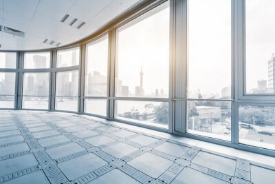 Fototapeta Pusty pokój biurowy w nowoczesnych budynkach biurowych w sunrise