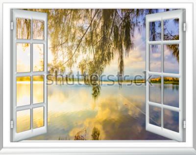 Fototapeta Raj z widokiem na ocean z okna na wyspie słoneczny letni dzień