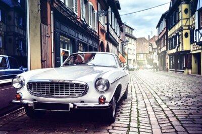 Fototapeta Retro car in old city street