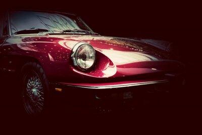 Fototapeta Retro klasyczny samochód na ciemnym tle. Vintage, eleganckie