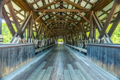 Fototapeta Rowell Covered Bridge is a covered bridge in Hopkinton, New Hampshire which carries Rowell Bridge Road over the Contoocook River. It is a long truss style bridge.