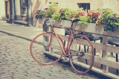 Fototapeta Rower na starej ulicy. Vintage stylizowane.