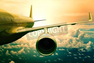 Fototapeta Samolot lecąc samolot pasażerski nad scape wykorzystania cloud samolotów do transportu i podróży biznesowych tle