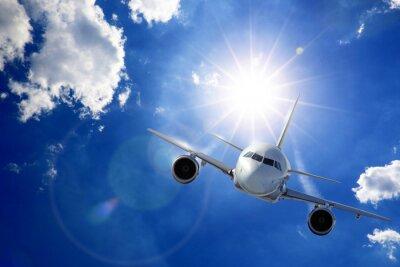 Fototapeta Samolot w Sonne und Wolken