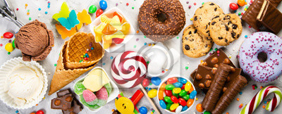 Fototapeta Selection of colorful sweets - chocolate, donuts, cookies, lollipops, ice cream top view