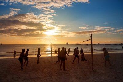 Fototapeta Silhouette ludzi grających w siatkówkę