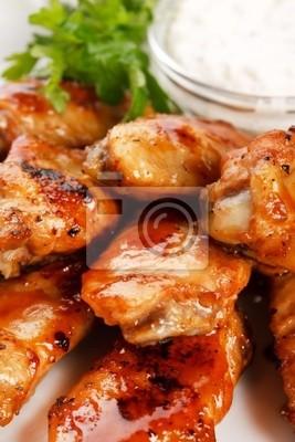 Fototapeta Skrzydełka z kurczaka z sosem