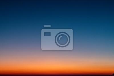 Fototapeta Sky gradient from blue to orange sunset