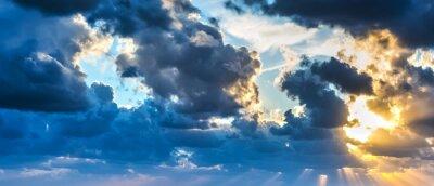 Fototapeta Słońce świeci przez chmury