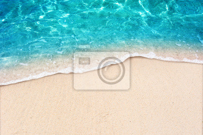 Fototapeta Soft blue ocean wave on clean sandy beach
