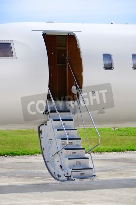 Fototapeta Stairs on a luxury private jet aircraft - Bombardier Global Express