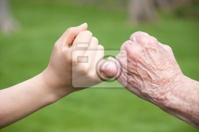 Fototapeta Starsi i Young Hands Obiecaj
