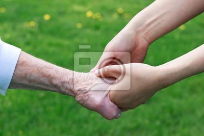 Fototapeta Starsi i Young Women Holding Hands
