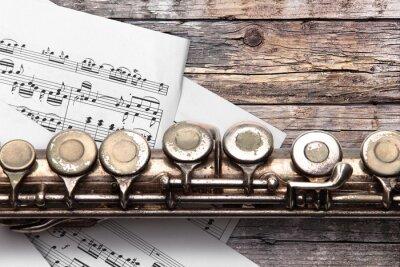 Fototapeta Stary flet z muzyką arkusza na zardzewiałych desek